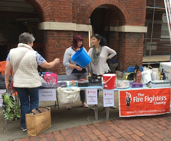 Firefighters charity climb fundraising table