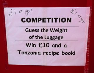 Guess the weight of the luggage poster