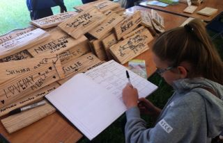 Signing roof shingles to raise funds