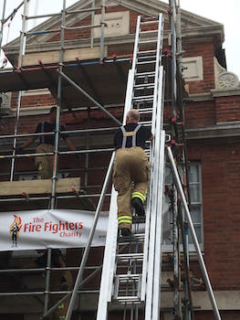 Firefighters charity climb. Climbing the ladder
